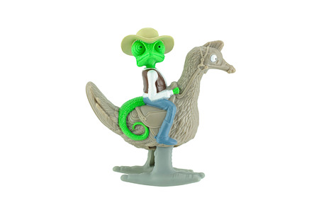 animated action: Bangkok,Thailand - June 1, 2015: Rango a chameleon ride an ostrich toy character from Rango American computer animated action comedy western film. There are plastic toy sold as part of Burger king toy.