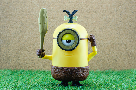 fictional character: Bangkok,Thailand - June 21, 2015: Cro-Minion on green grass  fictional character from Minions animated 3D film produced by Illumination Entertainment for Universal Pictures.