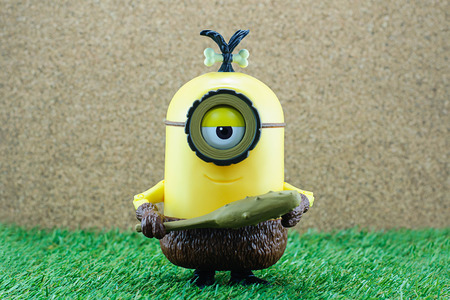 truncheon: Bangkok,Thailand - June 21, 2015: Cro-Minion on green grass  fictional character from Minions animated 3D film produced by Illumination Entertainment for Universal Pictures.
