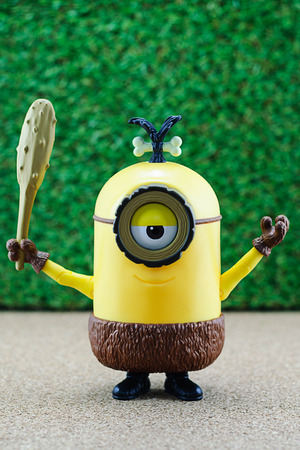 a cudgel: Bangkok,Thailand - June 22, 2015: Cro-Minion fictional character from Minions animated 3D film produced by Illumination Entertainment for Universal Pictures.