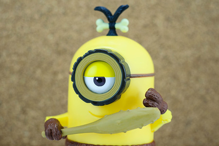 fictional character: Bangkok,Thailand - June 22, 2015: Head shot of Cro-Minion fictional character from Minions animated 3D film produced by Illumination Entertainment for Universal Pictures.