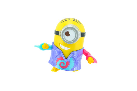 groovy: Bangkok, Thailand - September 27, 2015: Groovy minions with bananas toy character isolated on white background an action figure from Minions animated 3D film produced by Illumination Entertainment for Universal Pictures.