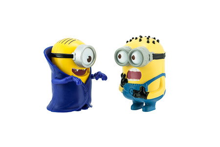 scaring: Bangkok, Thailand - September 27, 2015: Minion scaring vampire minions toy character isolated on white background an action figure from Minions animated 3D film produced by Illumination Entertainment for Universal Pictures.