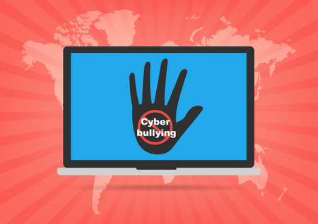 Computer laptop with hand and restrict sign no Cyberbullying on display screen. Concept of social media issue.