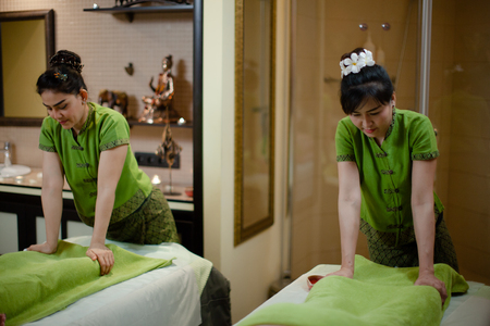 two thay Masseurs are doing massage in the spa salon. Beauty treatment concept.