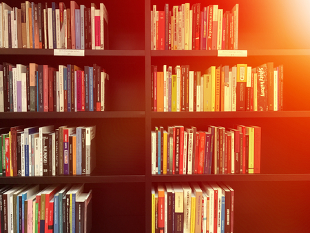 Shelves with books in a library Editorial