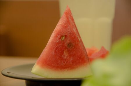 watermelon slice on the black dish