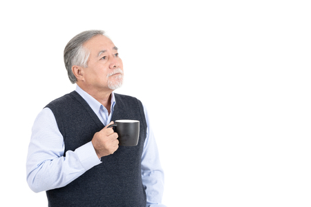 positive asian adult senior old man holding coffee cup with copy space for your promotional or text isolated on white background,People lifestyle concept. 스톡 콘텐츠