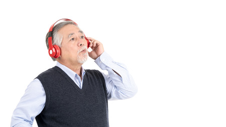happy asian senior old man listening to music with headphones and copy space for your promotional or text isolated on white background,People lifestyle concept.