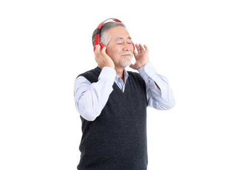 happiness asian senior old man smile wearing headphones having fun and listening favourite music with copy space for your promotional or text isolated on white background,People lifestyle concept.
