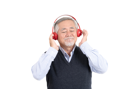 happiness asian senior old man smile listening to music with headphones and copy space for your promotional or text isolated on white background,People lifestyle concept.