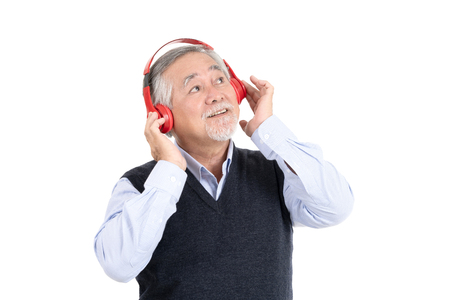 happiness asian senior old man smile wearing headphones having fun and listening favorite music with copy space for your promotional or text isolated on white background,People lifestyle concept.