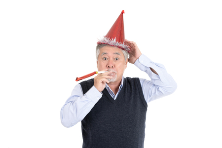 Portrait of a elderly man celebrating with a party hat with copy space for your advertisement or promotional text on isolated white background, People lifestyle concept.