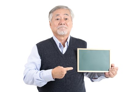 Portrait of happiness asian senior old man showing board and pointing copy space for your advertisement or promotional text on white background.