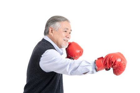 healthy fighter elderly man or business old man sport boxing red gloves copy space for your advertisement or promotional text on white background.