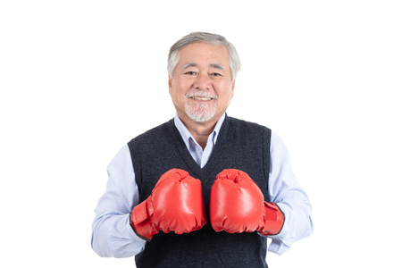 healthy fighter elderly man or business old man boxing red gloves copy space for your advertisement or promotional text on white background.