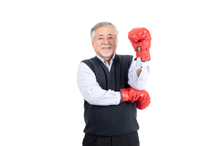 healthy fighter elderly man boxing red gloves copy space for your advertisement or promotional text on white background.