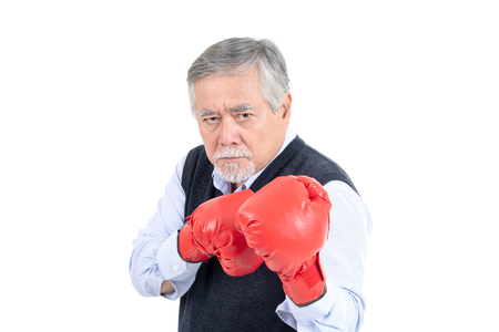 fighter asian senior old man boxing red gloves copy space for your advertisement or promotional text on isolated white background. 版權商用圖片