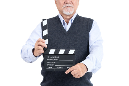 Close up  asian elderly man with movie clapper board looking at the camera copy space for your advertisement or promotional text on white background, People lifestyle concept. 스톡 콘텐츠