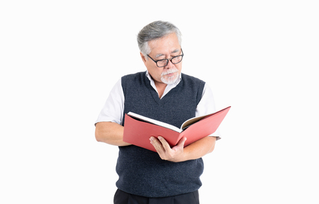 Adult senior old man wearing eyeglasses thinking and reading book with copy space for your promotional or text isolated on white background,People lifestyle concept.