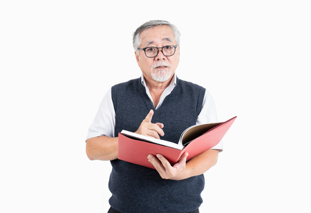 old man wearing eyeglasses look at camera thinking and reading book with copy space for your promotional or text isolated on white background, People lifestyle concept. 스톡 콘텐츠