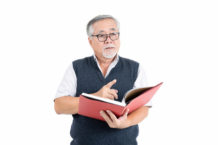Adult Mature old man wearing eyeglasses thinking and reading book with copy space for your promotional or text isolated on white background, People lifestyle concept Archivio Fotografico - 120932975