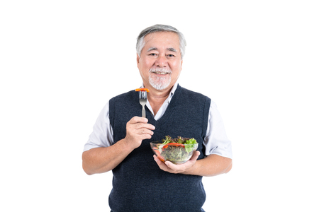 healthy elderly man eating a salad, Senior male health care eat vegetables and useful foods copy space for your advertisement or promotional text on isolated white background, People lifestyle concept 스톡 콘텐츠