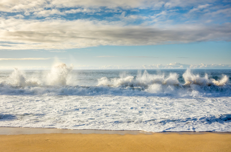Large waves breaking on the shore at Sunset Beach on the North Shore of Oahu, Hawaii.