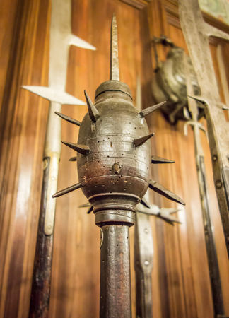 Close-up shot of a medieval weapon known as a morning star: a spiked club or bludgeon, similar to a mace. Stok Fotoğraf