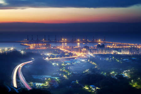 Taipei ports sunset and a highway through the port it