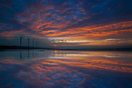 Reflection of the sunset and windmill  photo