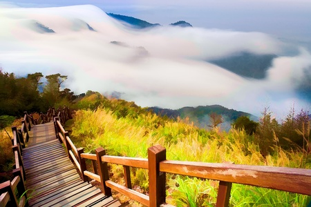 Painting style of Sunshine with mountain , cloud and fog in the morning