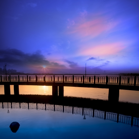 con dao: Sea stones at sunset with nice bridge