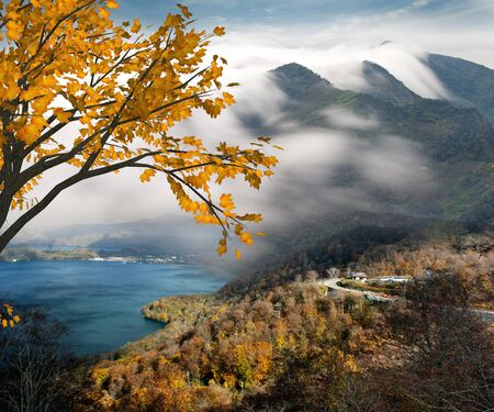 lake diablo: Beautiful mountain with nice maple and cloud background Stock Photo