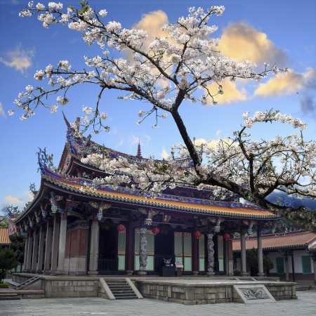 Sakura, temple and blue sky for adv or others purpose use Stock Photo - 17501481
