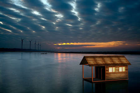 Small house on the water with nice reflection Stock Photo - 18120408