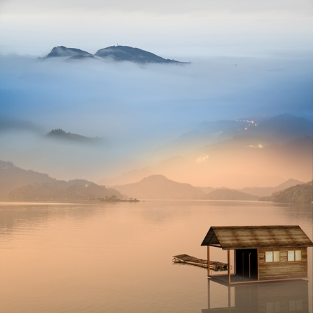 Small house on the water with nice reflection Stock Photo - 18120407