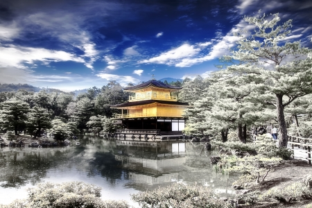 Peaceful Golden Pavilion Temple with snow in Kyoto, Japan