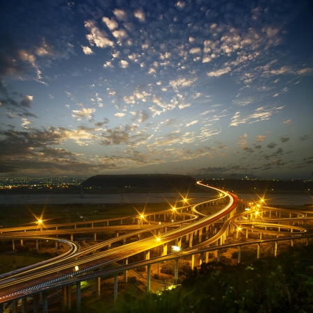 Highway in night with cars light in modern city in Taiwan, Asia  photo