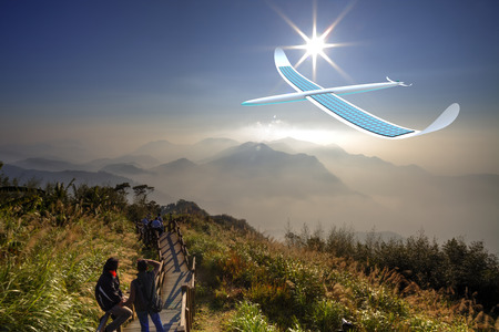 alternativ: Solar energy airplane on mountain scene Stock Photo