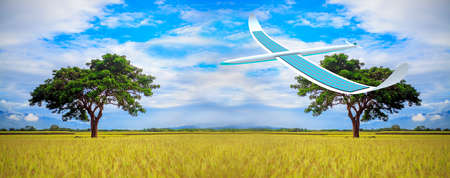Solar energy airplane on field landscape