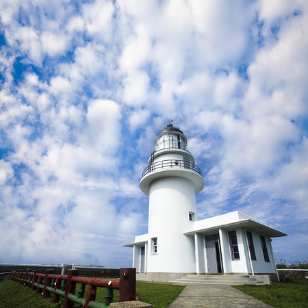 Lighthouse with beautiful sky photo