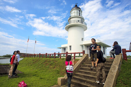 Tourists at Lighthouse area with beautiful sky