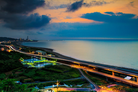 Sunset landscape with coastal road for adv or others purpose use photo