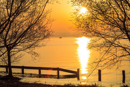 sunset beside the lake for adv or others purpose use photo