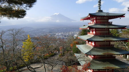 Image of the sacred mountain of Fuji in the background of blue sky at Japan