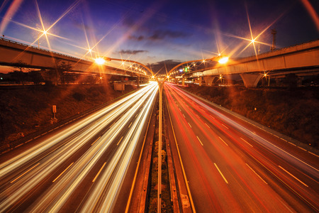 purpose: Highway in night with cars light in Taiwan for adv or others purpose use Stock Photo