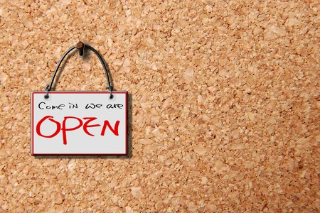 come in: come in we are open hanging sign isolated on wall for adv or others purpose use Stock Photo