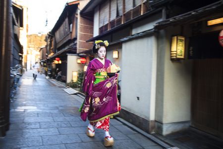 Kyoto, Japan - March 26, 2015: Apprentice geisha in western Japan, especially Kyoto. Their jobs consist of performing songs, dances, and playing the shamisen