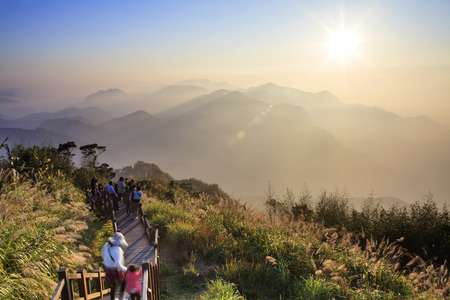 sunup: The amazing sunrise and sea of cloud with mountains and tree Stock Photo